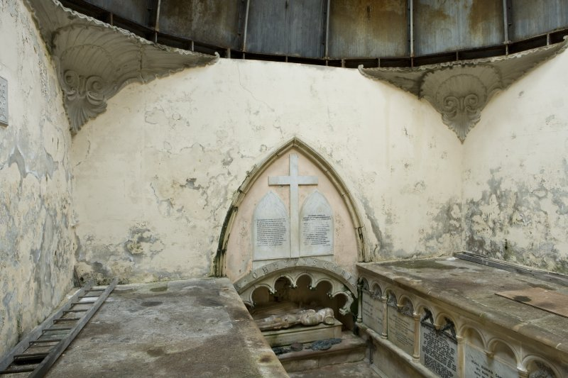 Interior. Elevated view from the North-East of the interior of the Argyll Mausoleum towards the South wall. Two arcaded stone platforms on the side walls (East and West) contain the coffins of the Argyll Campbells. Beneath the arch on the South wall a niche contains the 15th century effigies of Sir Duncan Campbell and his wife, Marjory.