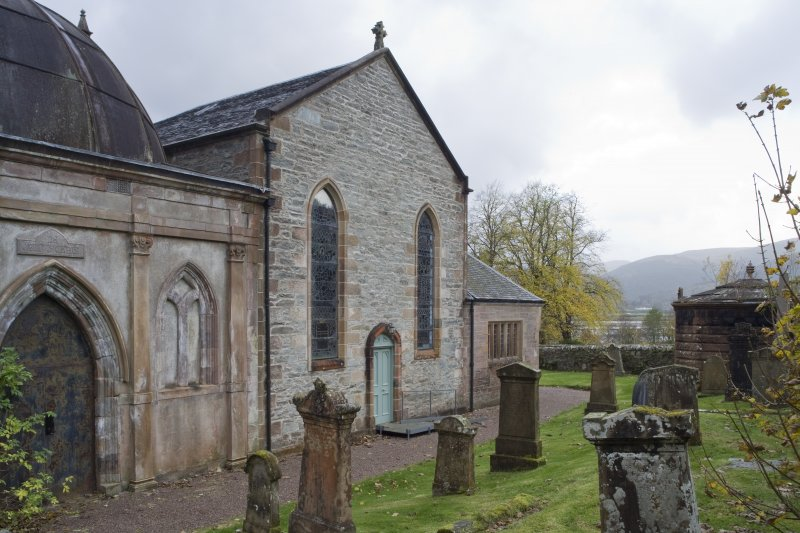 View of the North elevation of Church of St Munn's taken from North-East. Part view of adjoining Argyll Mausoleum.