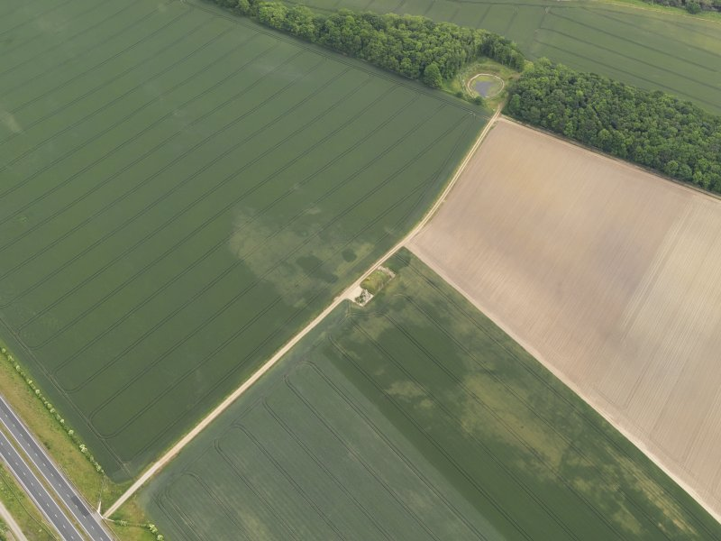 Oblique aerial view of the cropmarks of the possible quarries, taken from the WNW.
