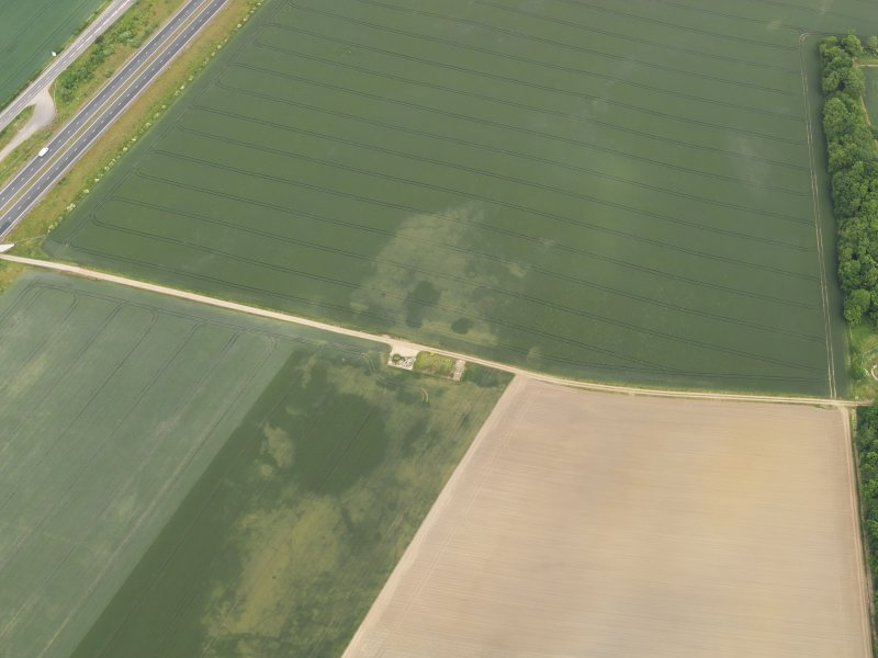 Oblique aerial view of the cropmarks of the possible quarries, taken from the WSW.