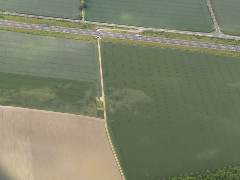 Oblique aerial view of the cropmarks of the possible quarries, taken from the SSE.