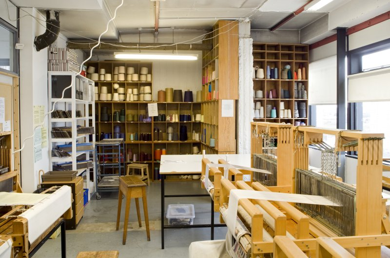 View of weaving looms and thread reels in Textiles studio within Newbery Tower