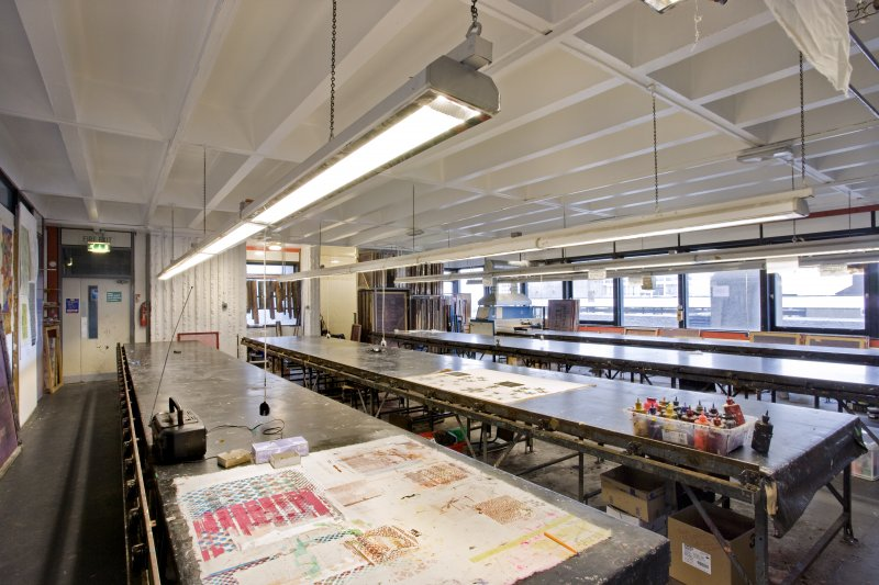 View across screen printing tables of printmaking studio within Newbery Tower