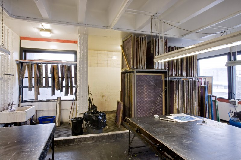 View of wet workspace, washout bay and silk screen racks in printmaking studio within Newbery Tower