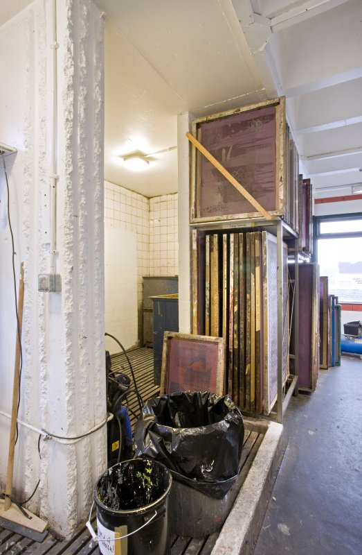 View into wet workspace and frame racks in printmaking studio of Newbery Tower