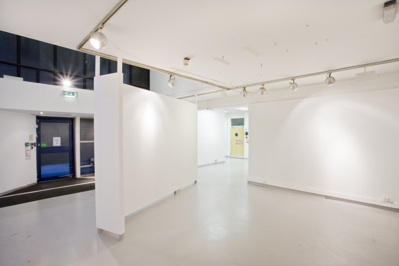 General view of ground floor exhibition area, with main entrance door to left, within Newbery Tower