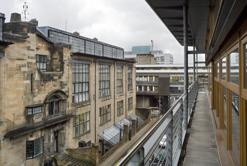 View looking west along external walkway on south elevation of Foulis building, with Mackintosh building to left and Bourdon building to background.