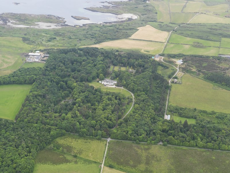 General oblique aerial view of Gigha centred on Achamore House and its policies, taken from the ESE.