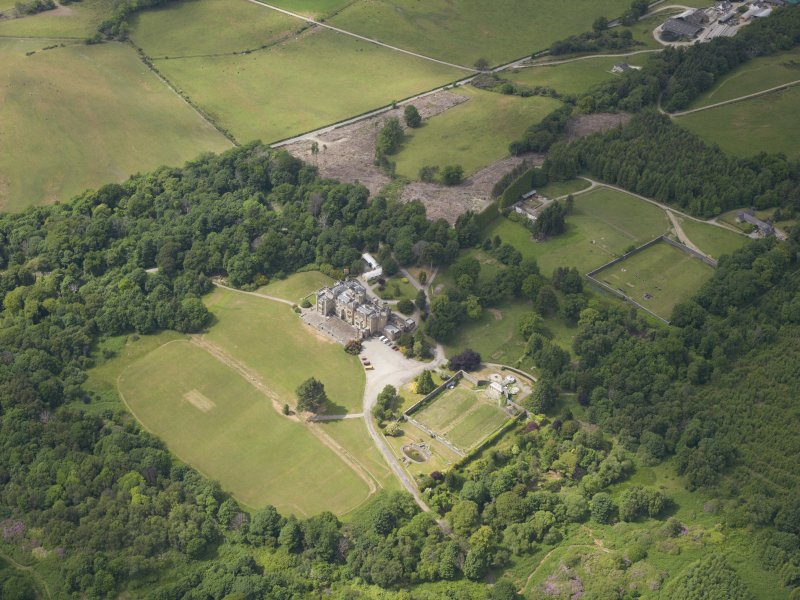 Oblique aerial view of Castle Toward country house and policies, taken from the SE.