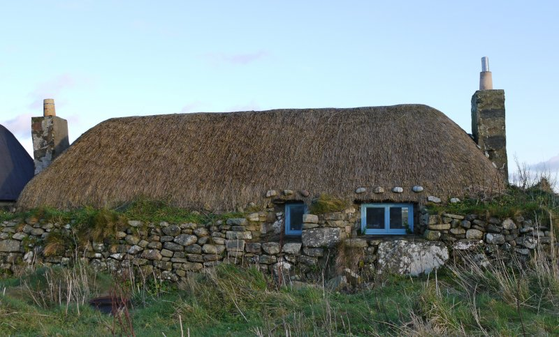 View of the West elevation of the thatched cottage at 13 Kilmoluaig, Tiree, taken from the West.