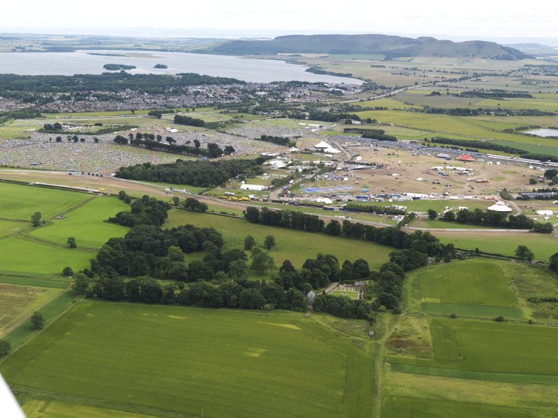 General oblique aerial view of T in the Park with Loch Leven beyond, looking to the ESE.