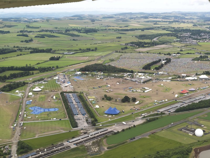 Oblique aerial view of T in the Park, looking to the NE.