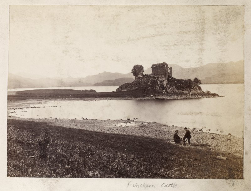 Page 26/2. Distant view of Fincharn Castle. Titled 'Fincharn Castle/' PHOTOGRAPH ALBUM No. 146 : THE ANNAN ALBUM.