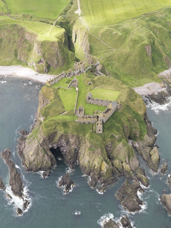 Oblique aerial view of Dunnottar Castle, looking to the W.