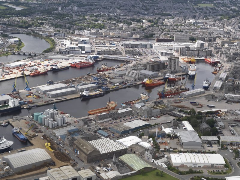 Oblique aerial view of Aberdeen Harbour with the Victoria Bridge beyond, looking to the SW.