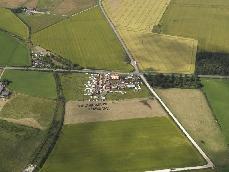 Oblique aerial view of the agricultural show at Rannachy with Rathven Station beyond, looking to the NNW.