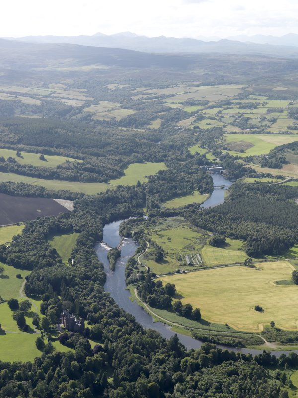 General oblique aerial view of Beaufort Castle and grounds with the River Beauly byond, looking to the W.