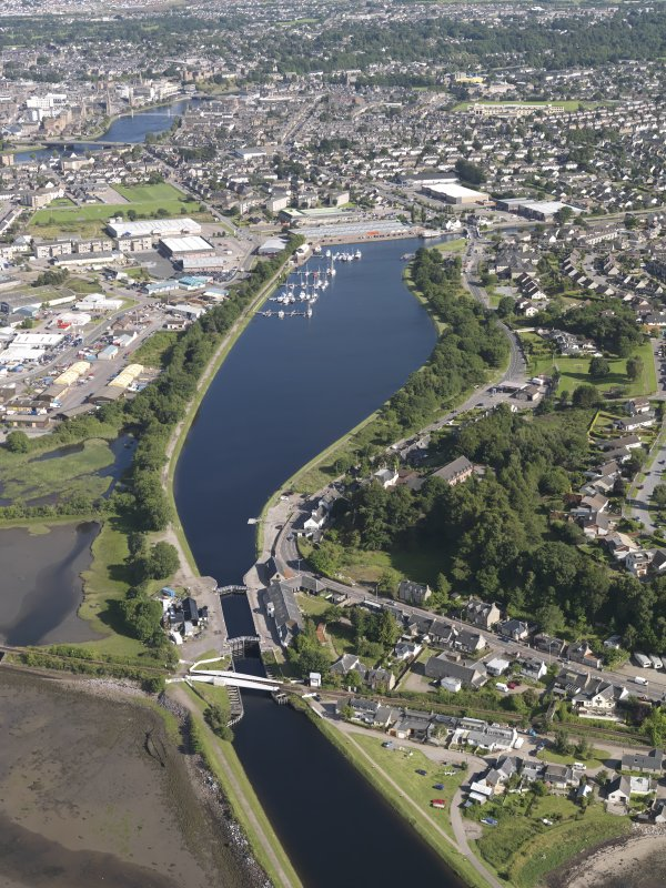 Oblique aerial view of the Caledonian Canal centred on the Muirtown Basin in Inverness, looking to the SE.