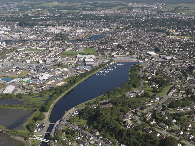 Oblique aerial view of the Caledonian Canal centred on the Muirtown Basin in Inverness, looking to the ESE.