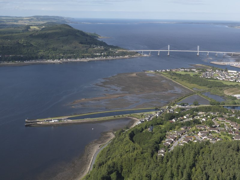 Oblique aerial view of the Caledonian Canal at Clachnaharry with the Kessock Bridge beyond, looking to the NE.
