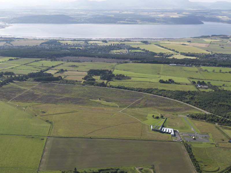 General oblique aerial view of Inverness with the Beauly Firth and Kessock Bridge beyond, looking to the NNW.