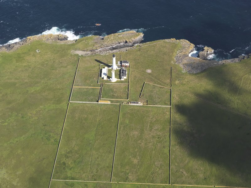 Oblique aerial view of the Muckle Skerry lighthouse, taken from the S.
