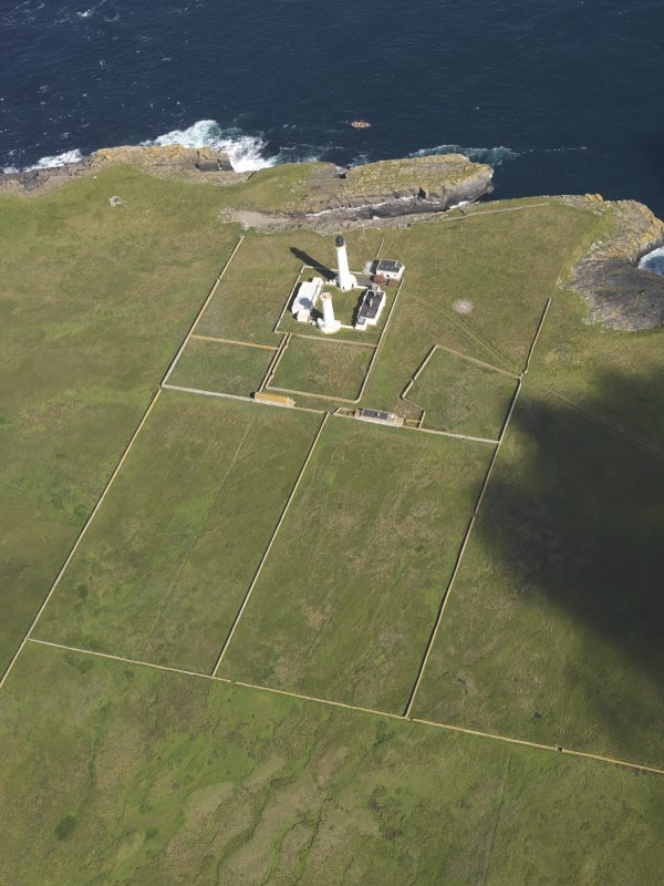 Oblique aerial view of the Muckle Skerry lighthouse, taken from the SSE.