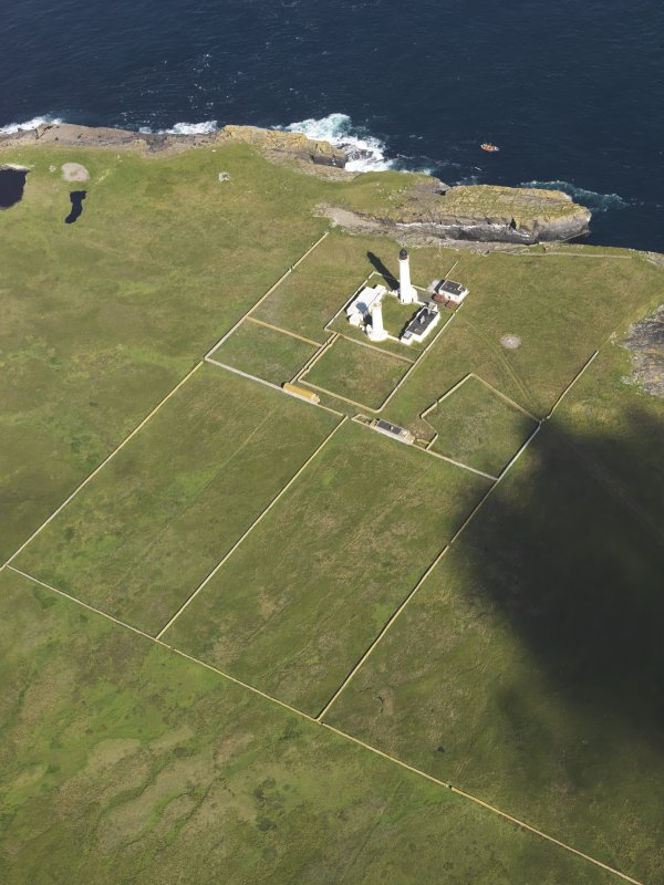 Oblique aerial view of the Muckle Skerry lighthouse, taken from the SE.