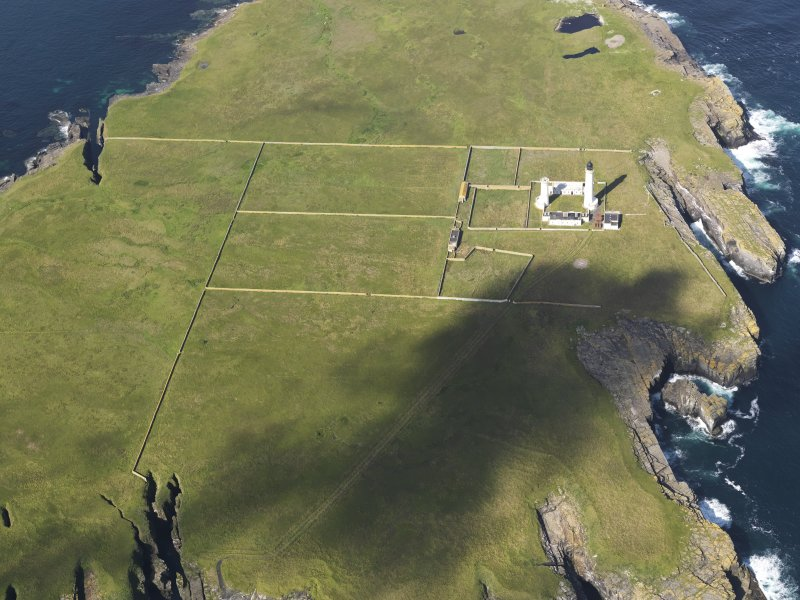 Oblique aerial view of the Muckle Skerry lighthouse, taken from the E.