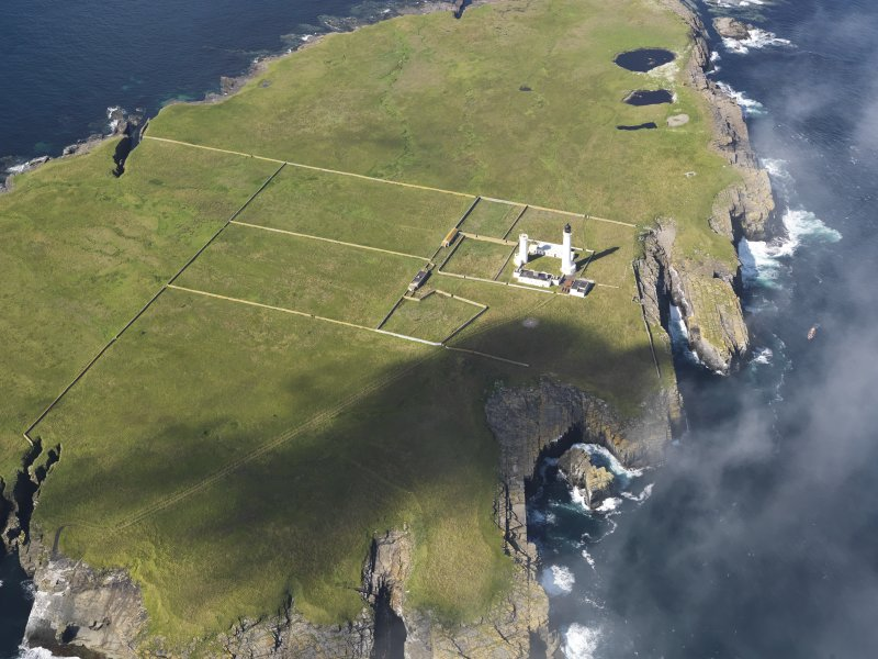 Oblique aerial view of the Muckle Skerry lighthouse, taken from the ENE.