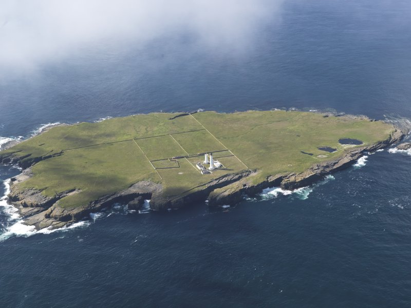 General oblique aerial view of the Muckle Skerry lighthouse, taken from the NE.