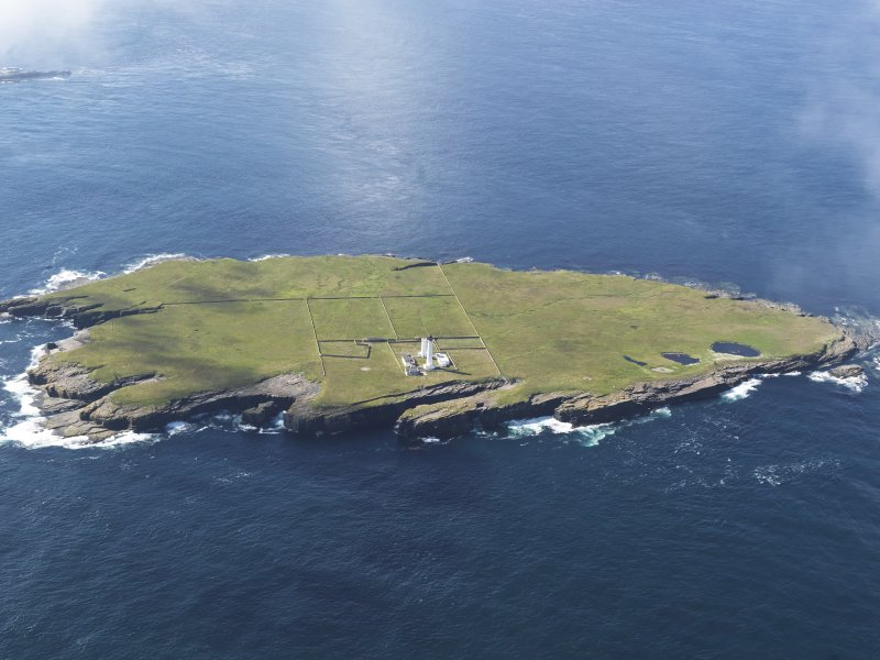 General oblique aerial view of the Muckle Skerry lighthouse, taken from the NNE.