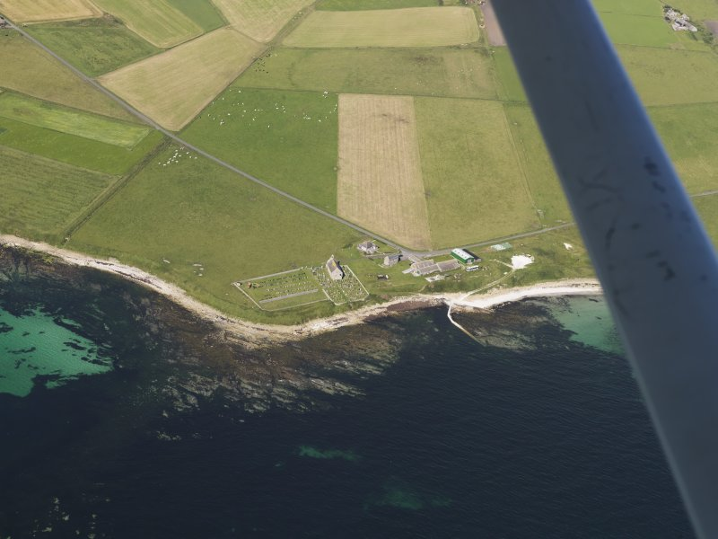 General oblique aerial view of St Ninian's Church, Skail, taken from the ESE.