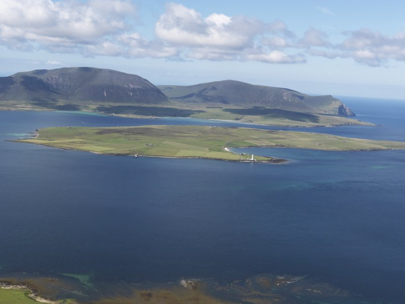 General oblique aerial view looking across Graemsay towards Hoy, taken from the NE.