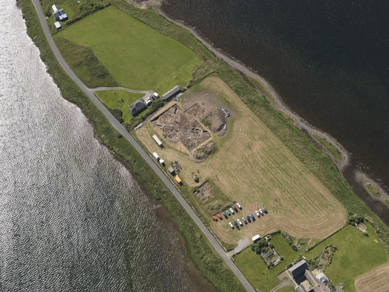 Oblique aerial view of the excavations at the Ness of Brodgar, taken from the NNW.