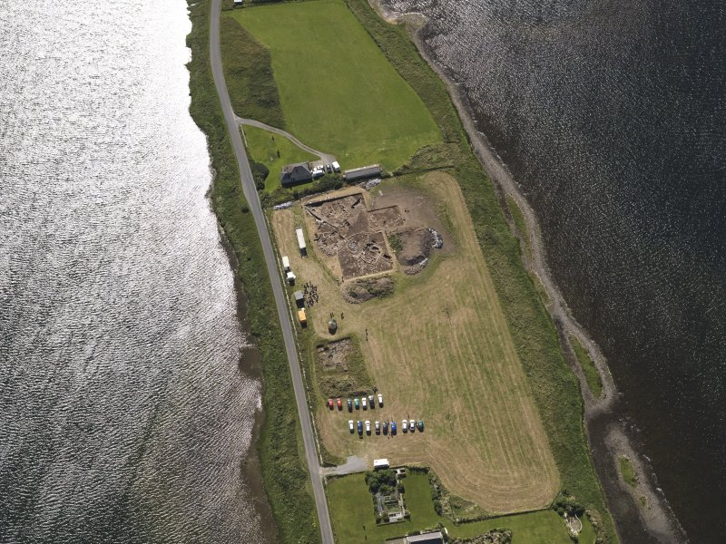 Oblique aerial view of the excavations at the Ness of Brodgar, taken from the NW.