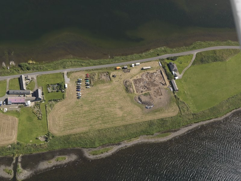 Oblique aerial view of the excavations at the Ness of Brodgar, taken from the SW.