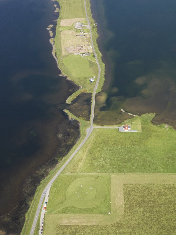 Oblique aerial view of the Stones of Stenness with the excavations at the Ness of Brodgar beyond, taken from the SE.