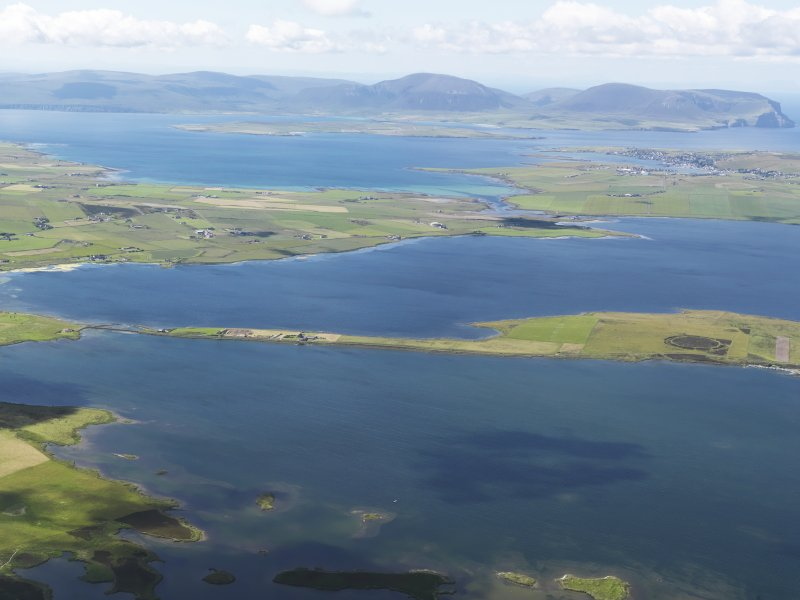 General oblique aerial view looking across the Lochs of Harray and Stenness with Hoy in the distance, taken from the NNE.