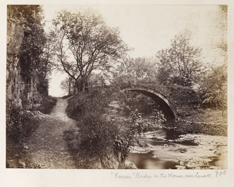 "Page 32/2 General view of river Mouse, near Lanark. Titled ' ""Roman""bridge on the Mouse, near Lanark.' PHOTOGRAPH ALBUM No 146: 'THE THOMAS ANNAN ALBUM:"