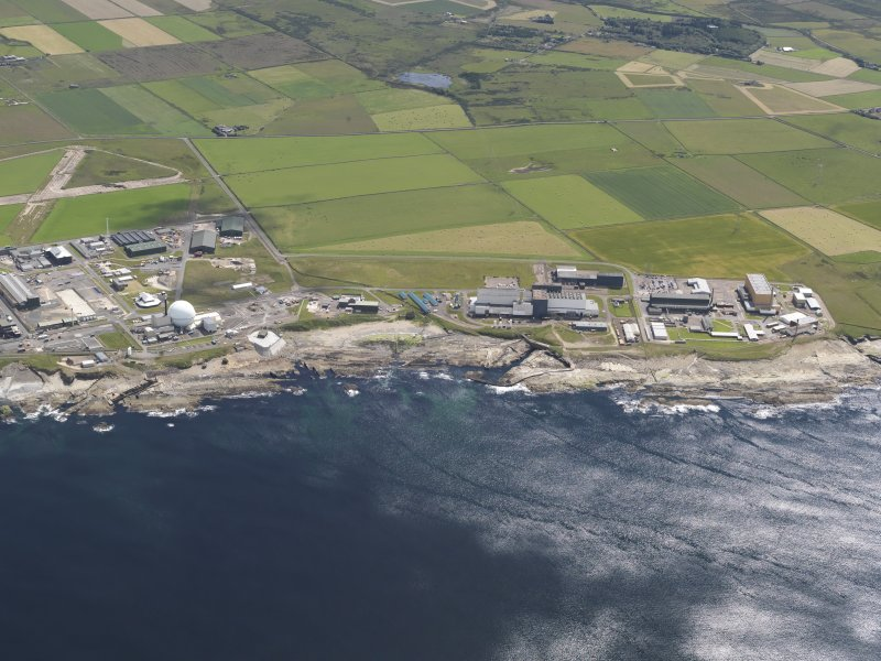 General oblique aerial view of the Dounreay Nuclear Research Facility, taken from the NW.