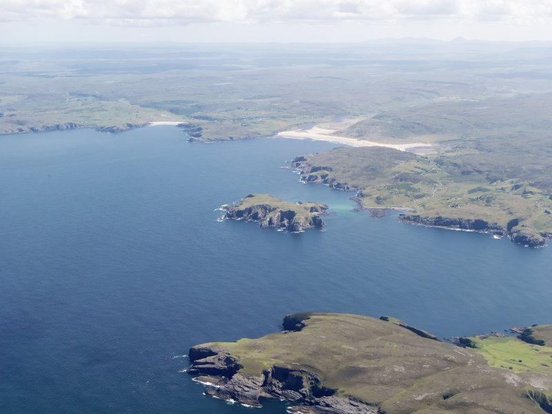 General oblique aerial view looking across Neave Island from Eilean nan Ron with Bettyhill in the distance, taken from the NW.