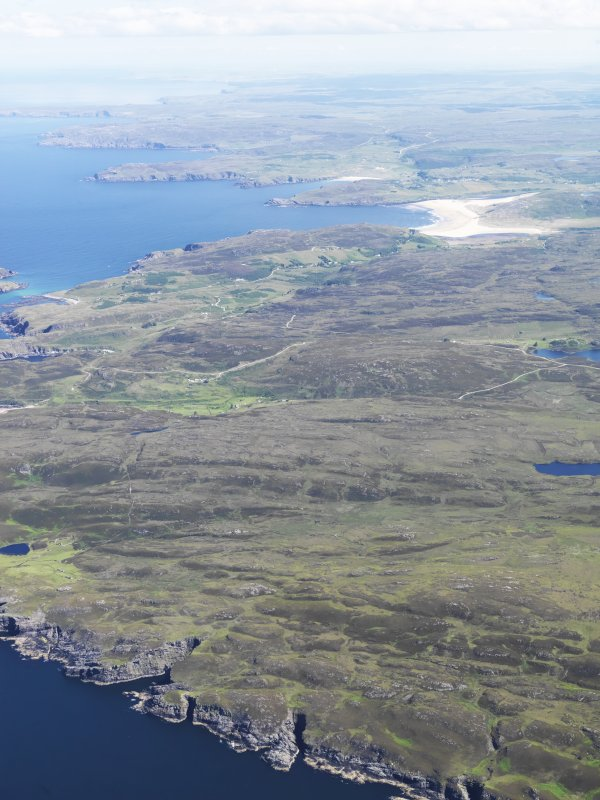 General oblique aerial view looking along the coast towards Bettyhill, taken from the W.