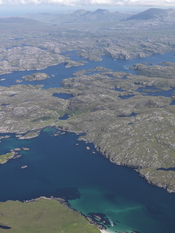 General oblique aerial view looking across the Sound of Handa towards Tarbet with Foinaven beyond, taken from the WSW.