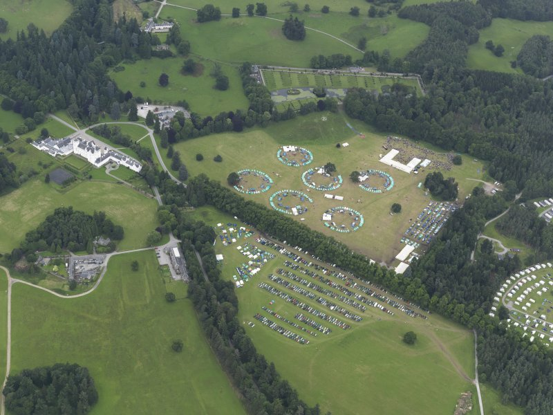 General oblique aerial view of Blair Castle policies and the agricultural fair, looking to the NNE.