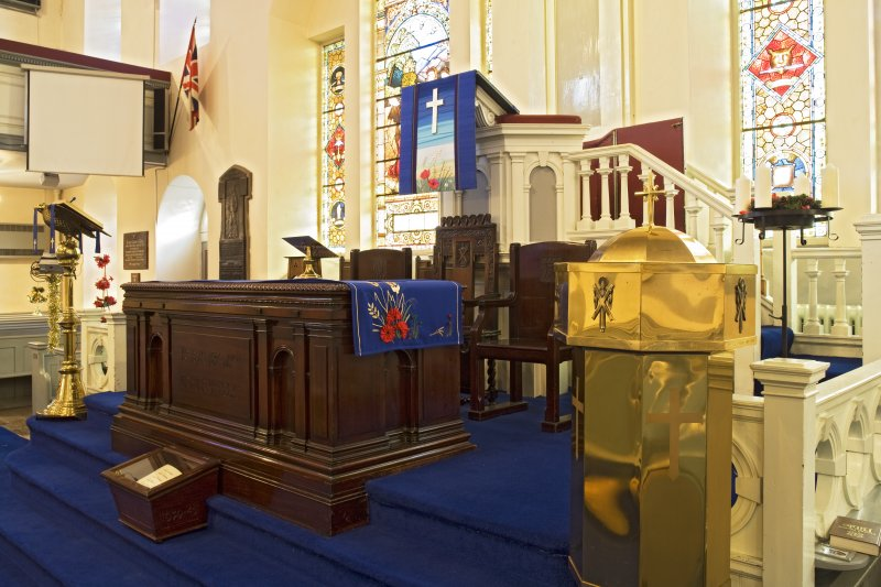 Interior. View of communion table, pulpit and font