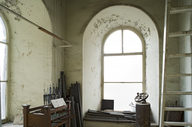Interior. Belfry room (off gallery), view from N showing arched window