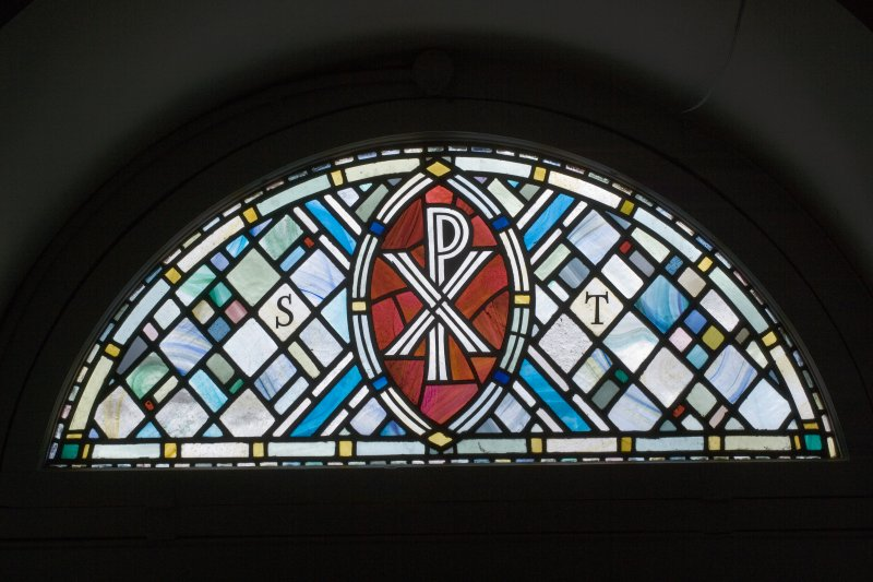 Interior. E wall, detail of stained glass fanlight
