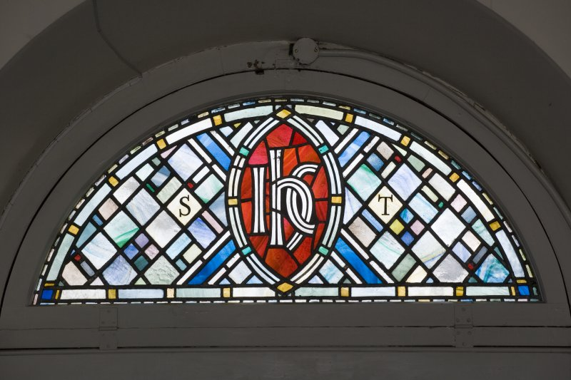 Interior. Ground floor, detail of stained glass fanlight