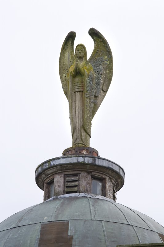 Angel sculpture atop dome. Detail